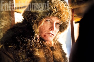 """Daisy Domergue aka """"The Prisoner"""" (Jennifer Jason Leigh), an """"infamous outlaw"""" who's been captured and transported to prison in Red Rock by Ruth."""