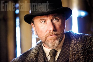 """Oswaldo Mobray aka """"The Little Man"""" (Tim Roth), a fellow with a """"continental-soundig name and fancy tailoring"""" who claims to be """"the new hangman"""" of Red Rock."""