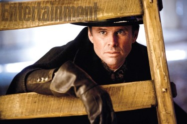 """Chris Mannix aka """"The Sheriff"""" (Walton Goggins), a """"man in a black hat"""" who says he's the local sheriff."""