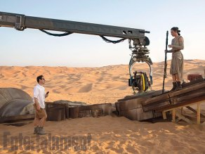 Director J.J. Abrams and actress Daisy Ridley in a previously released behind-the-scenes shot. Abrams was recruited to join the film when Lucasfilm president Kathleen Kennedy asked him a question about another young Star Wars desert-dweller...