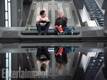 Director J.J. Abrams relaxes on the set of The First Order's Starkiller Base with his co-writer Lawrence Kasdan (The Empire Strikes Back). Note the dark red script pages in Kasdan's hand, a security measure to prevent copying.
