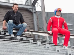 Hugh Jackman & Taron Egerton in EDDIE THE EAGLE