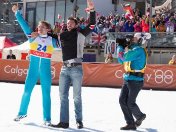 Taron Egerton & Hugh Jackman in EDDIE THE EAGLE