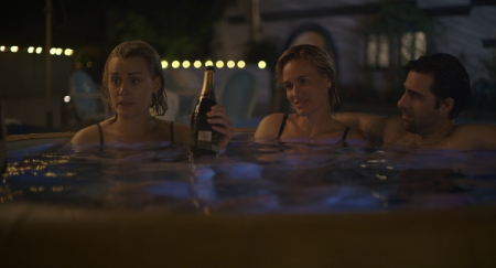 Taylor Schilling & Jason Schwarzmann in The Overnight