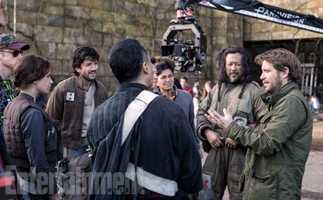 """Multicultural Cast In this behind the scenes shot from the Yavin-4 base, Edwards consults with some of his lead actors: Jones, Diego Luna, Yen, and Jiang and Tudyk (in his performance capture suit). The movie's Rebel team is a deliberately diverse mix from our own planet, meant to reflect a galaxy filled with a wide variety of humans from many different worlds (not to mention a healthy mix of creatures and aliens). """"People are coming to the Rebellion because something has happened that has galvanized or politicized them,"""" says Hart. """"The question just becomes: What are those triggers for different people in different places?"""""""